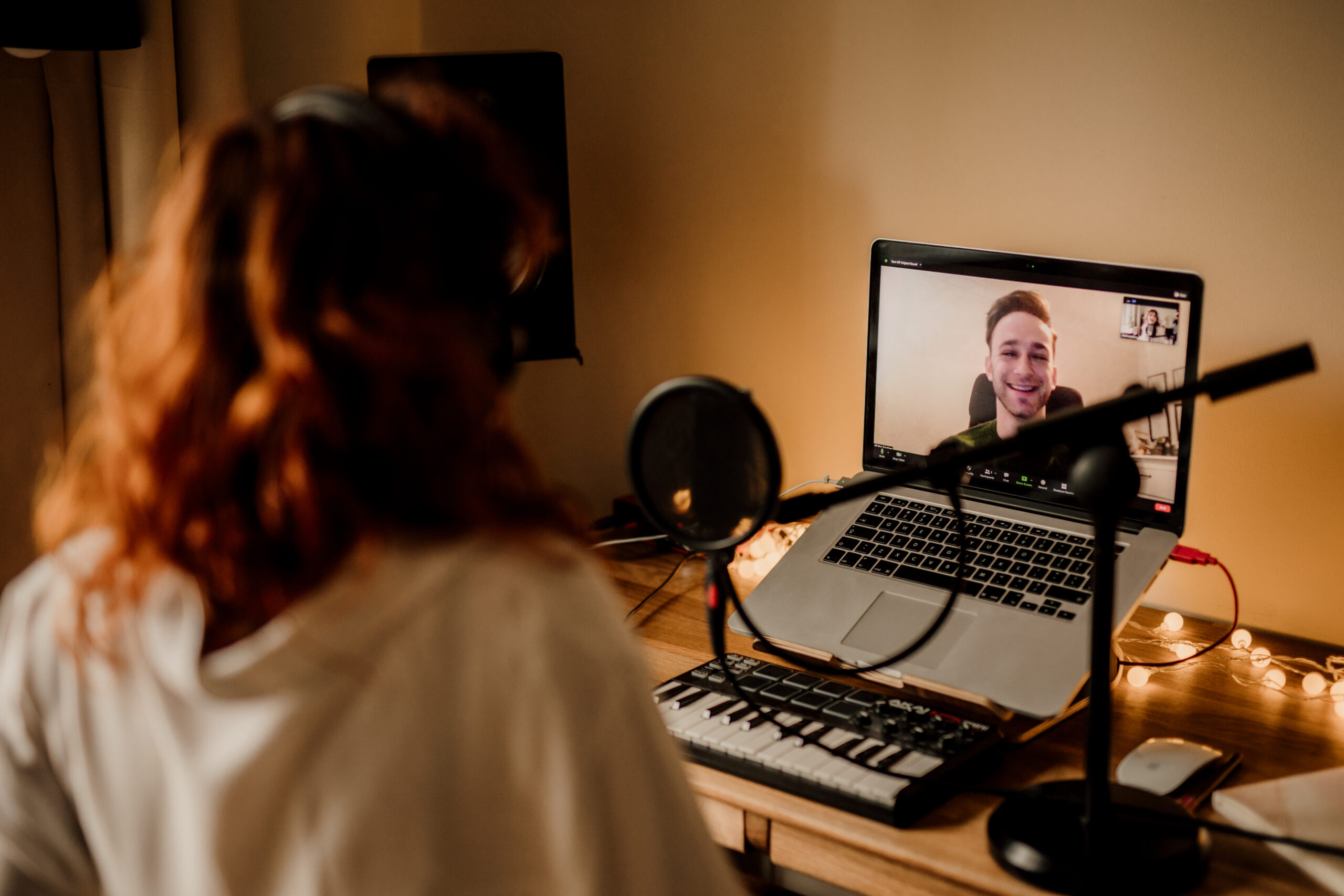Male singing student having an online lesson with a redheaded singing teacher with a title individual coaching.